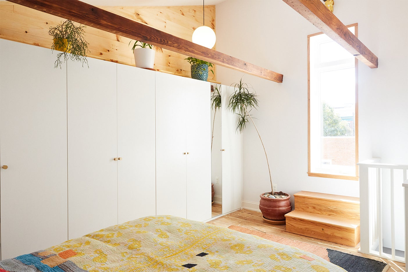 airy bedroom with wood beams