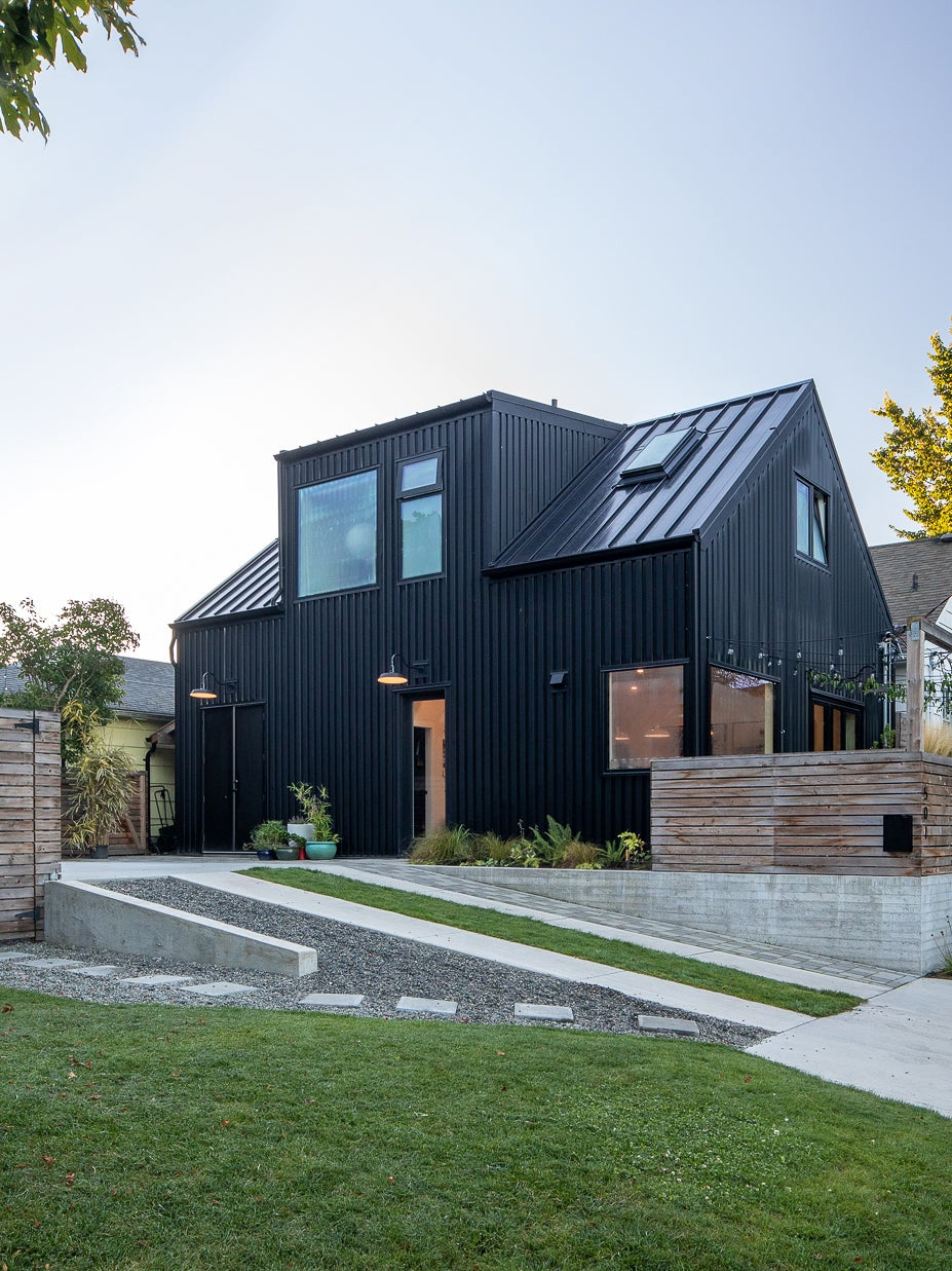 black stille house with sloped driveway