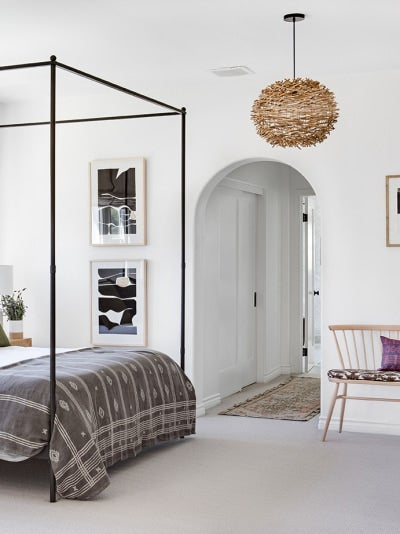 a rug bridging two rooms
