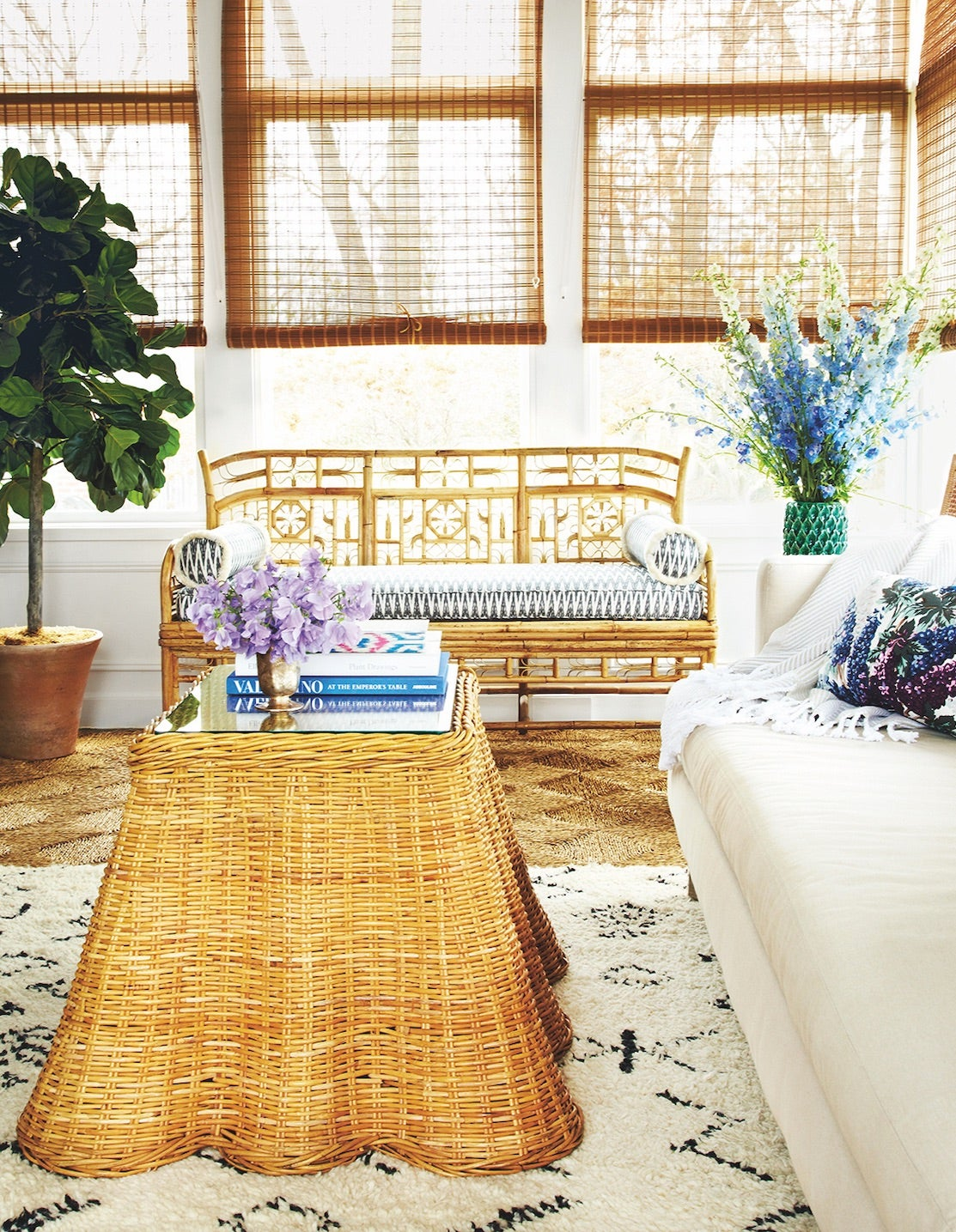a living room with rattan furniture