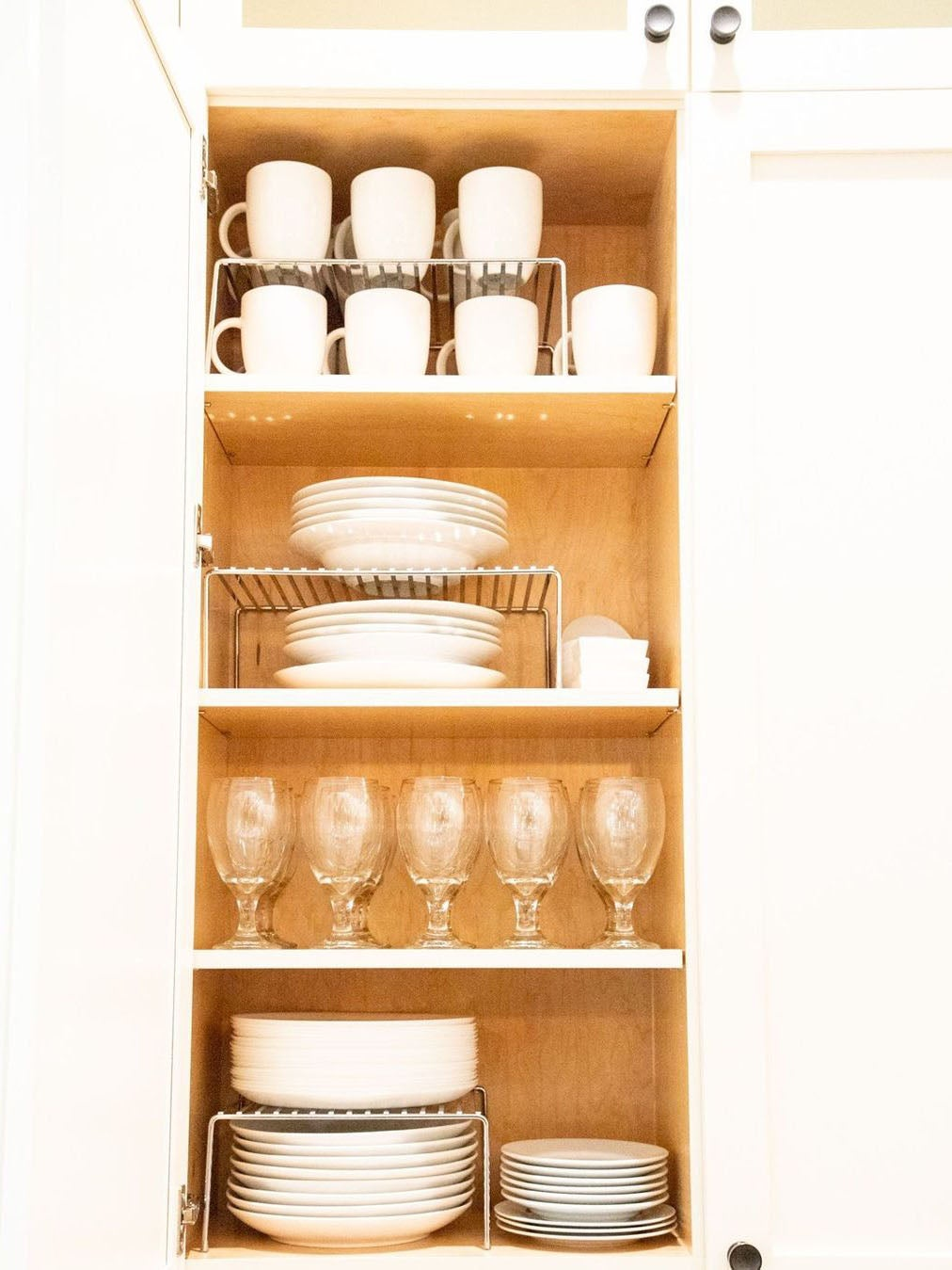 white plates stacked in cabinet