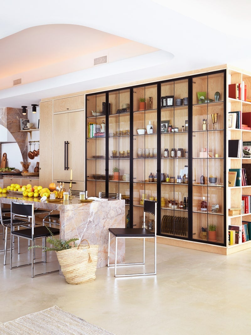 open kitchen with floor to ceiling glass cabinets