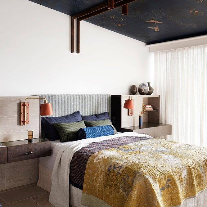 moody bedroom with yellow comforter
