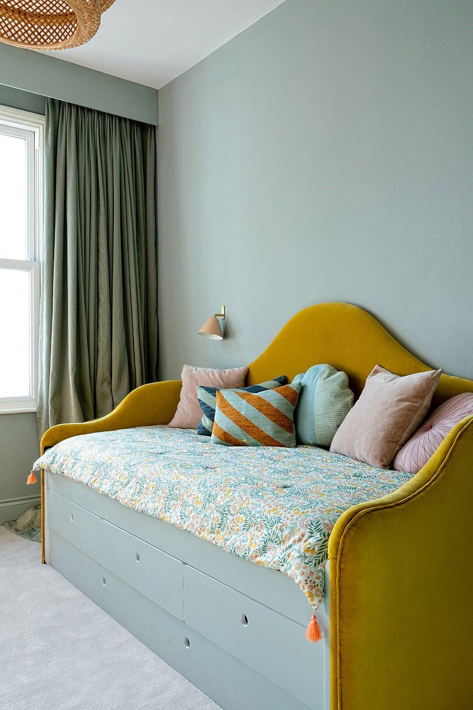 curved yellow velvet bedroom