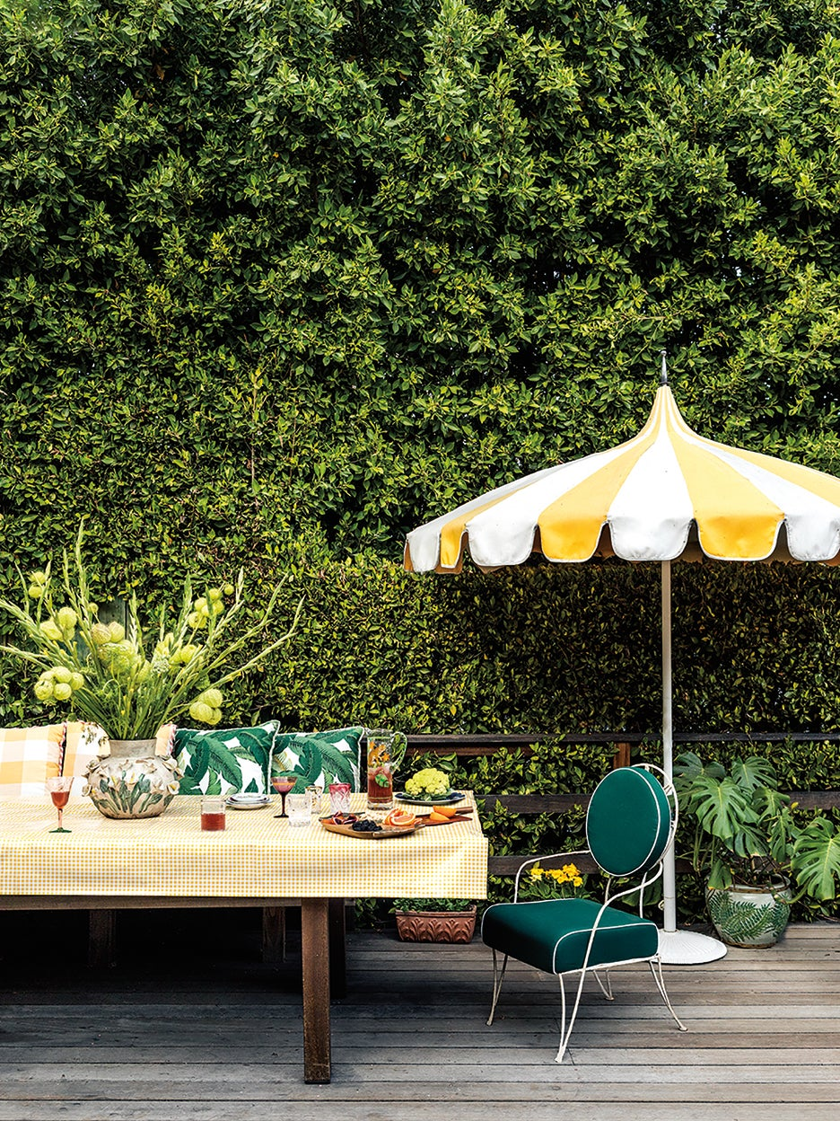 ivy covered wall with dining table
