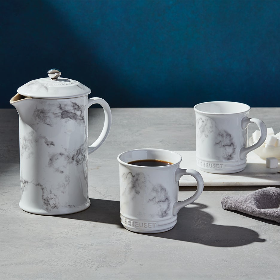 Le Creuset French press and mugs in marble finish