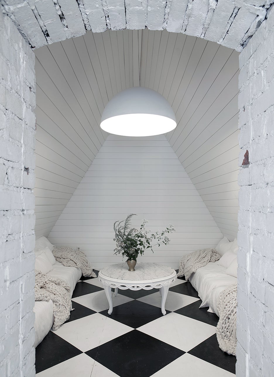 attic lounge space with checkered floors