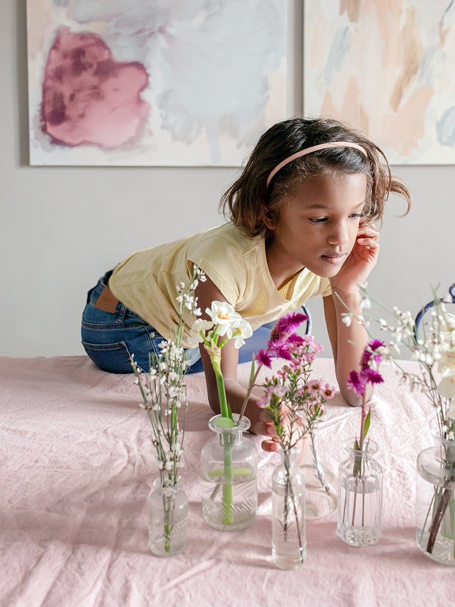 Bud vase tablescape for Easter with girl