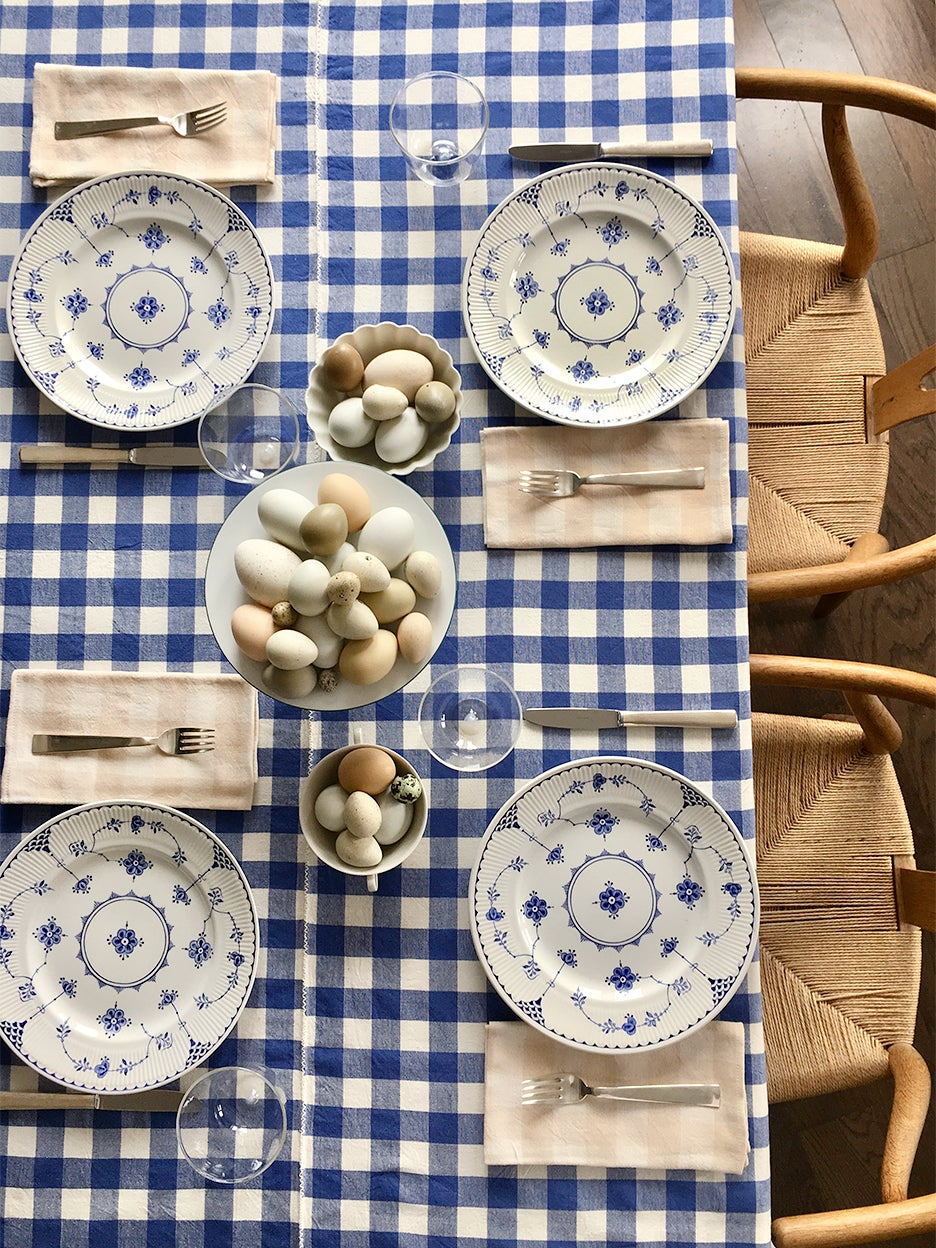 Gingham tablecloth with bowls of eggs on the table