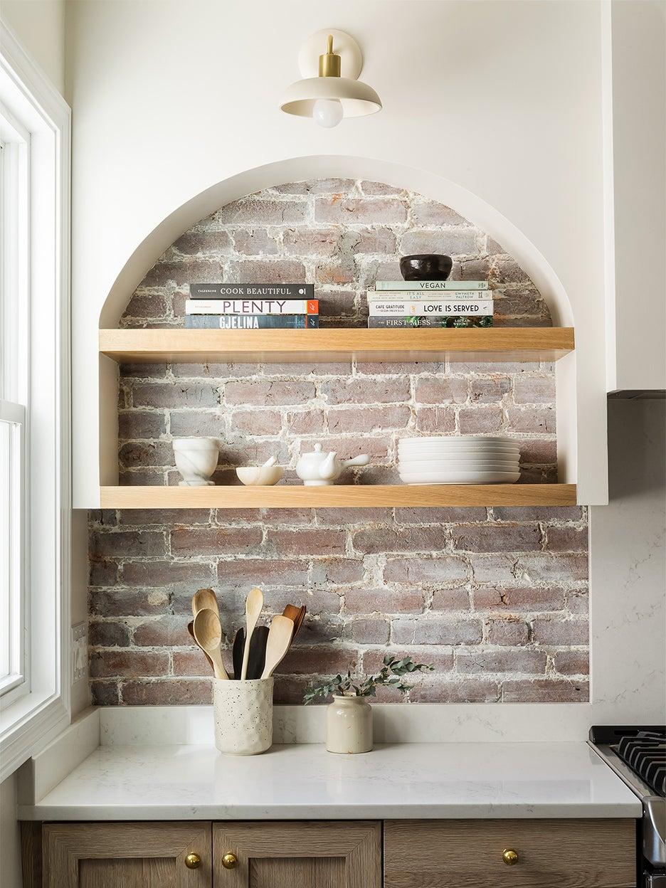 brick behind open shelves