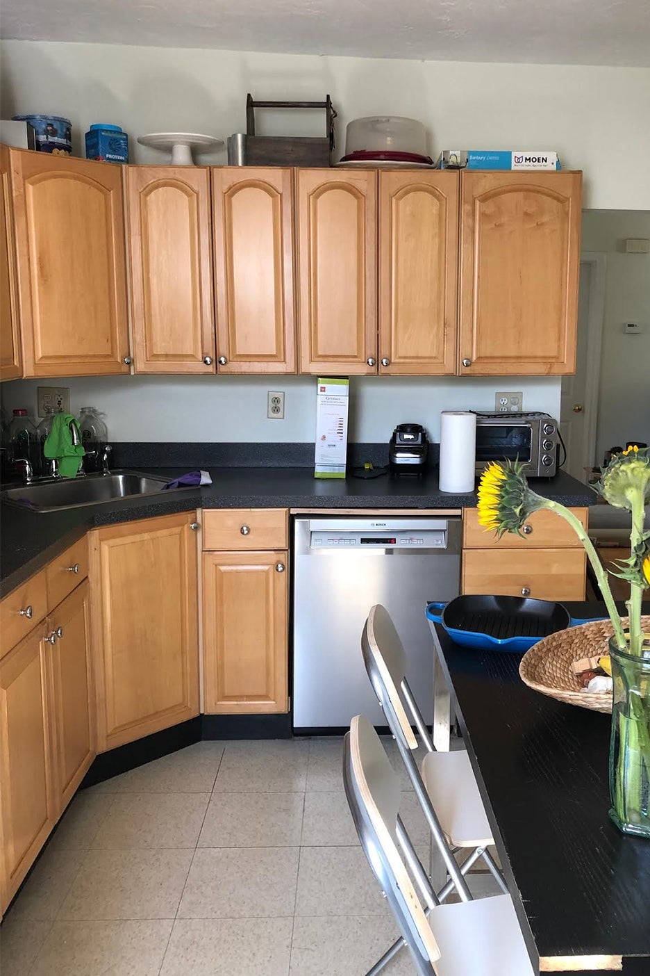 dated kitchen wiht black counters