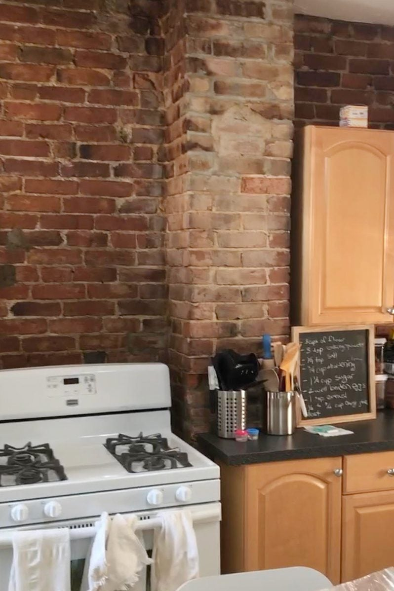 dated brick kitchen wall behind oven