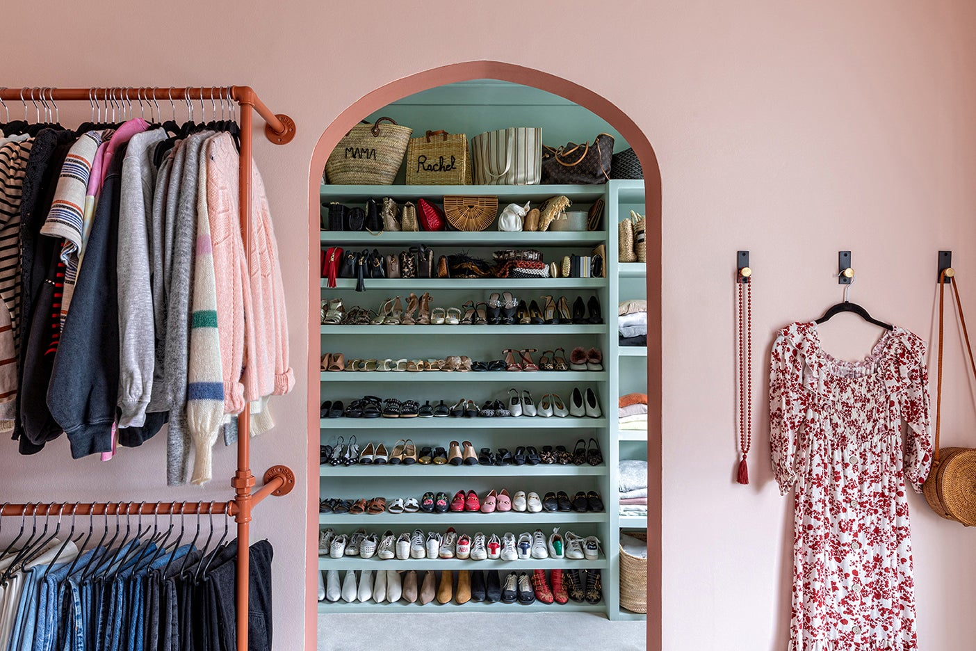 pink arch leading to green walk-in closet