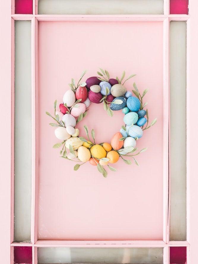 egg wreath on pink door