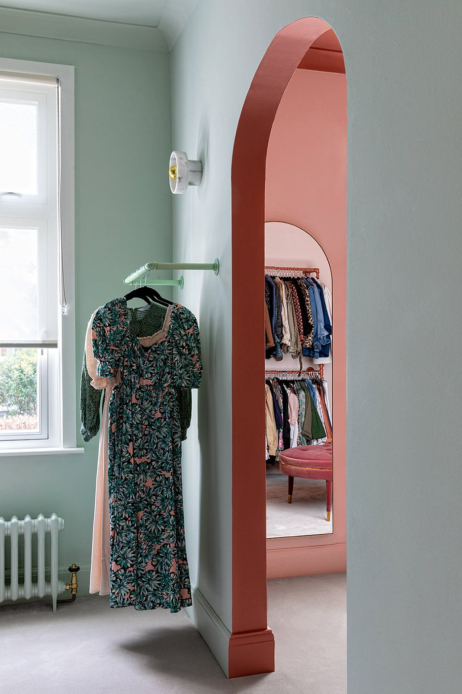 green closet with pink archway