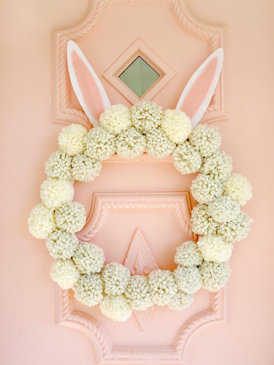 pom pom wreath on pink door
