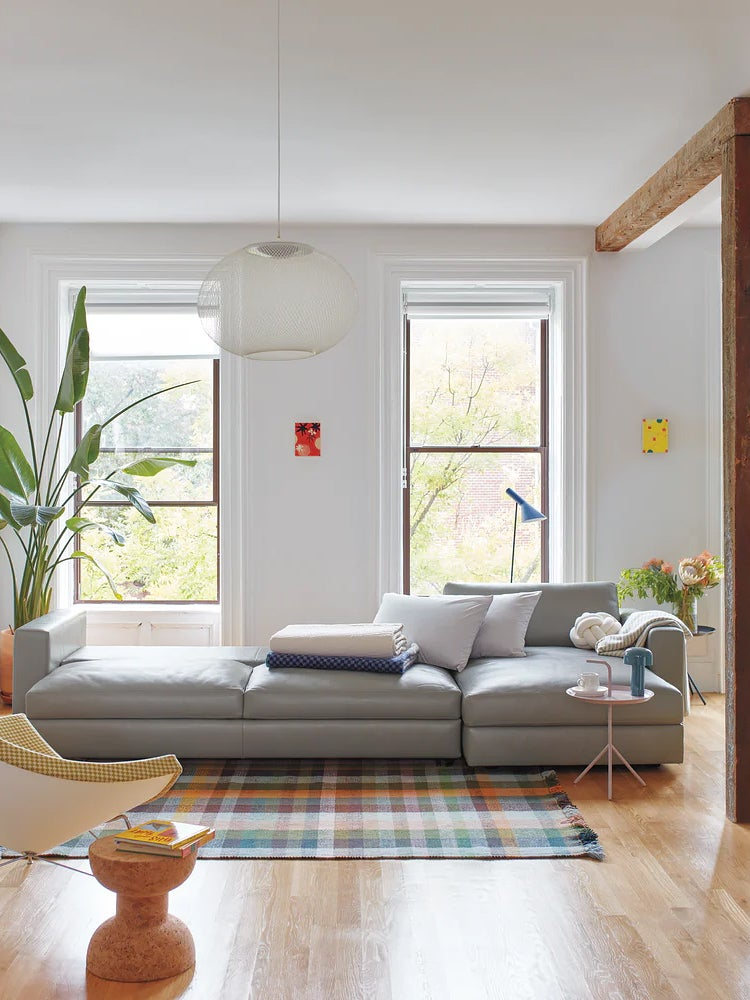 Sectional sofa with storage in an airy living room