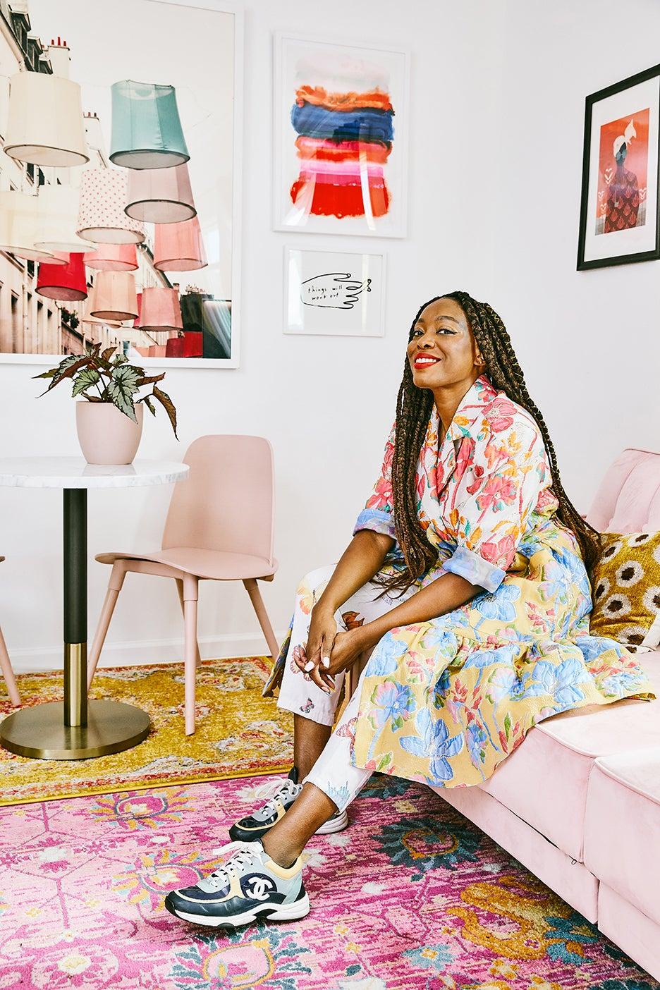 autumn adeigbo on pink sofa in office
