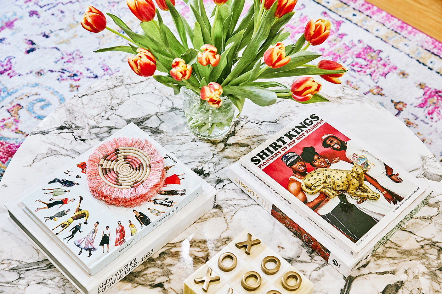 pink coasters and books on marble coffee table