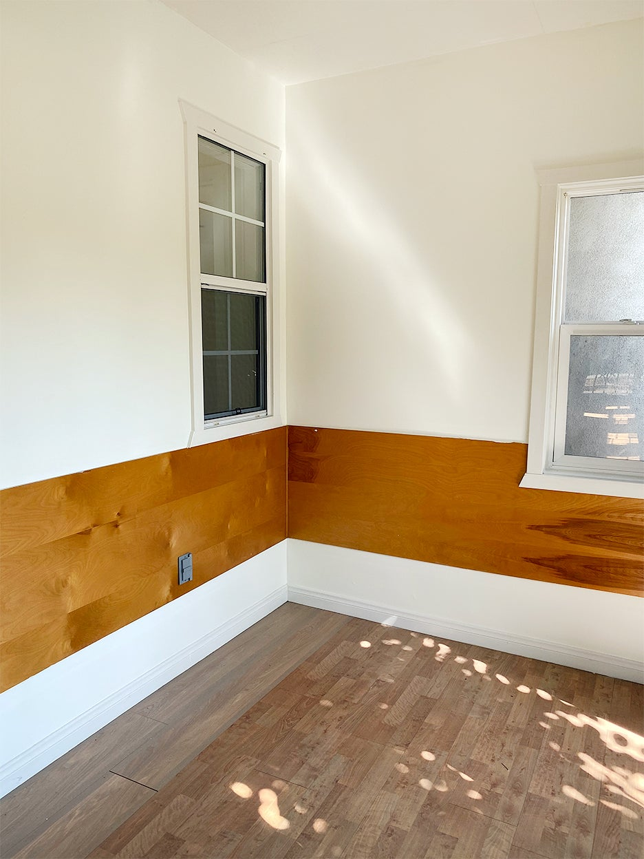 plain room with wood paneling