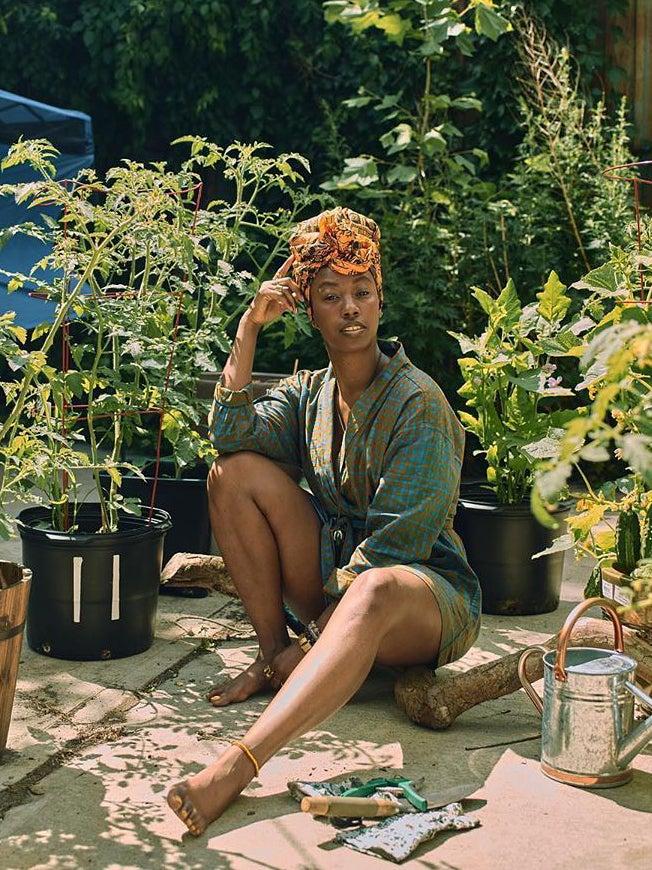 Woman sitting in her garden
