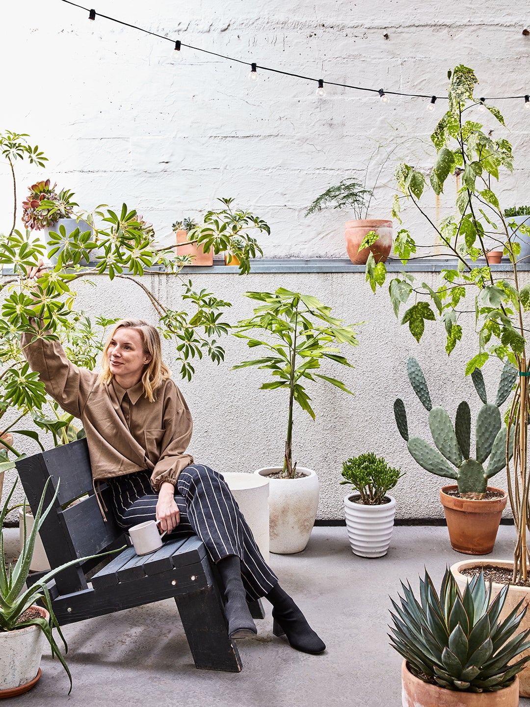 Women on patio surrounded by plants