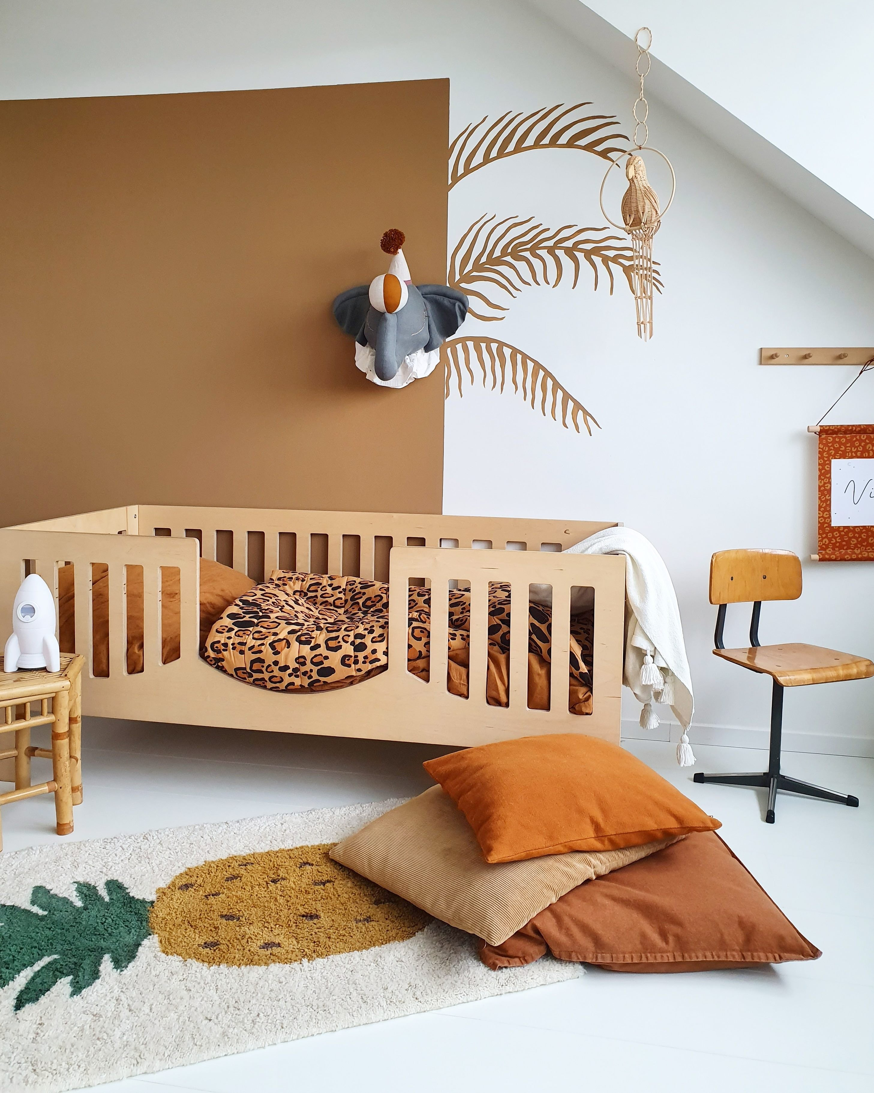 Terracotta rooms - wood crib with color blocked brown paint