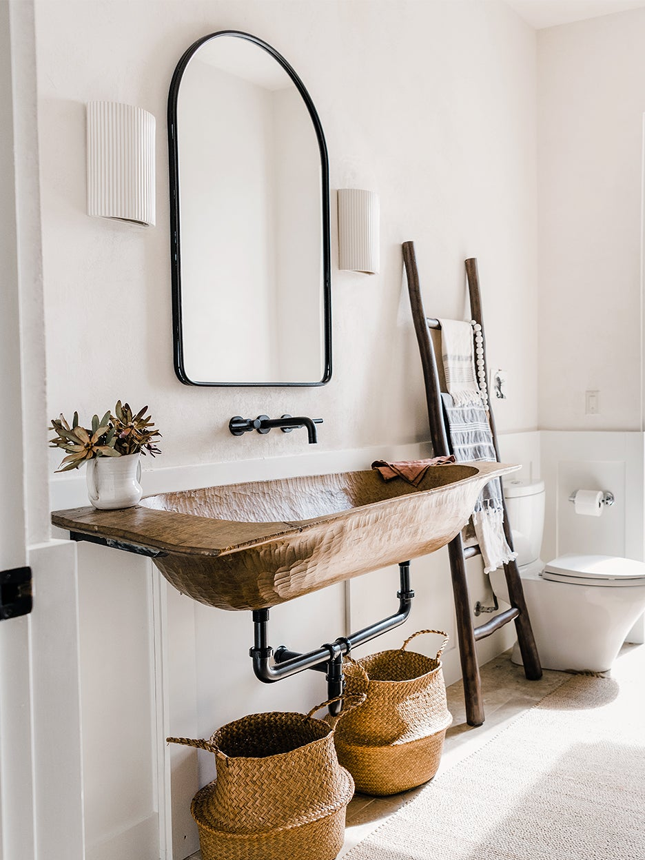 rustic bathroom with baskets and ladder