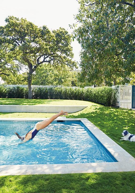 tyler swimming in her pool