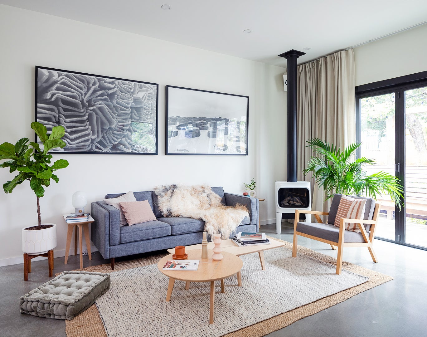 moderning living room with layered rugs