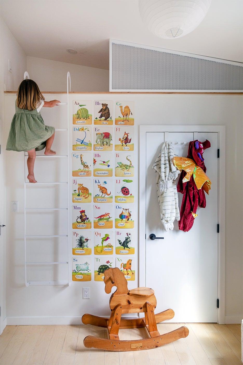girl crawlign up a ladder