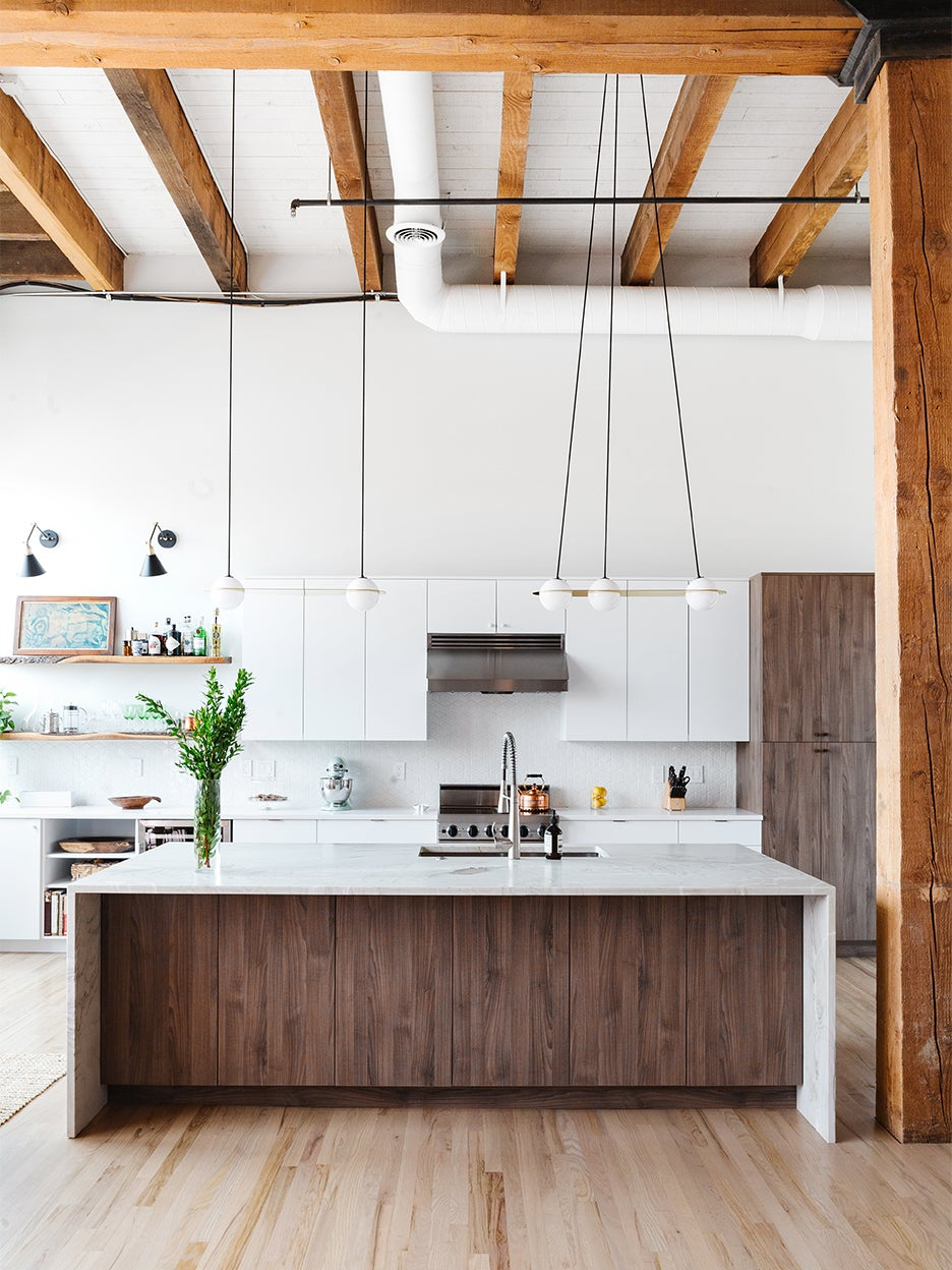 white kitchen with high ceiling beams