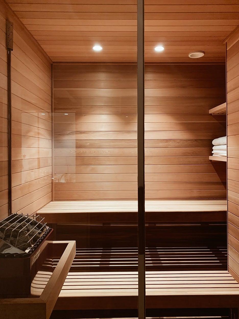 wood sauna with lights on