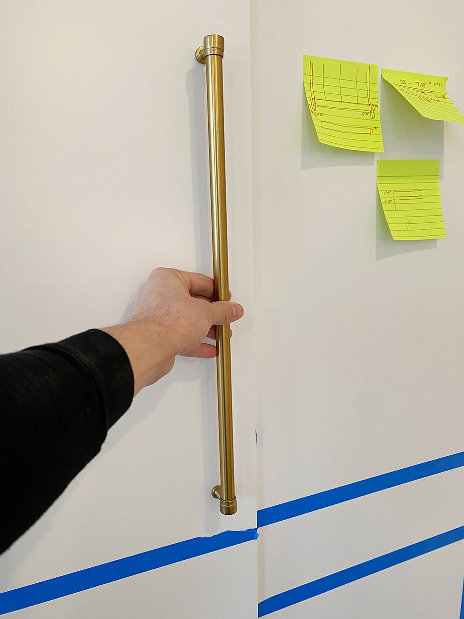 person holding handle up to door