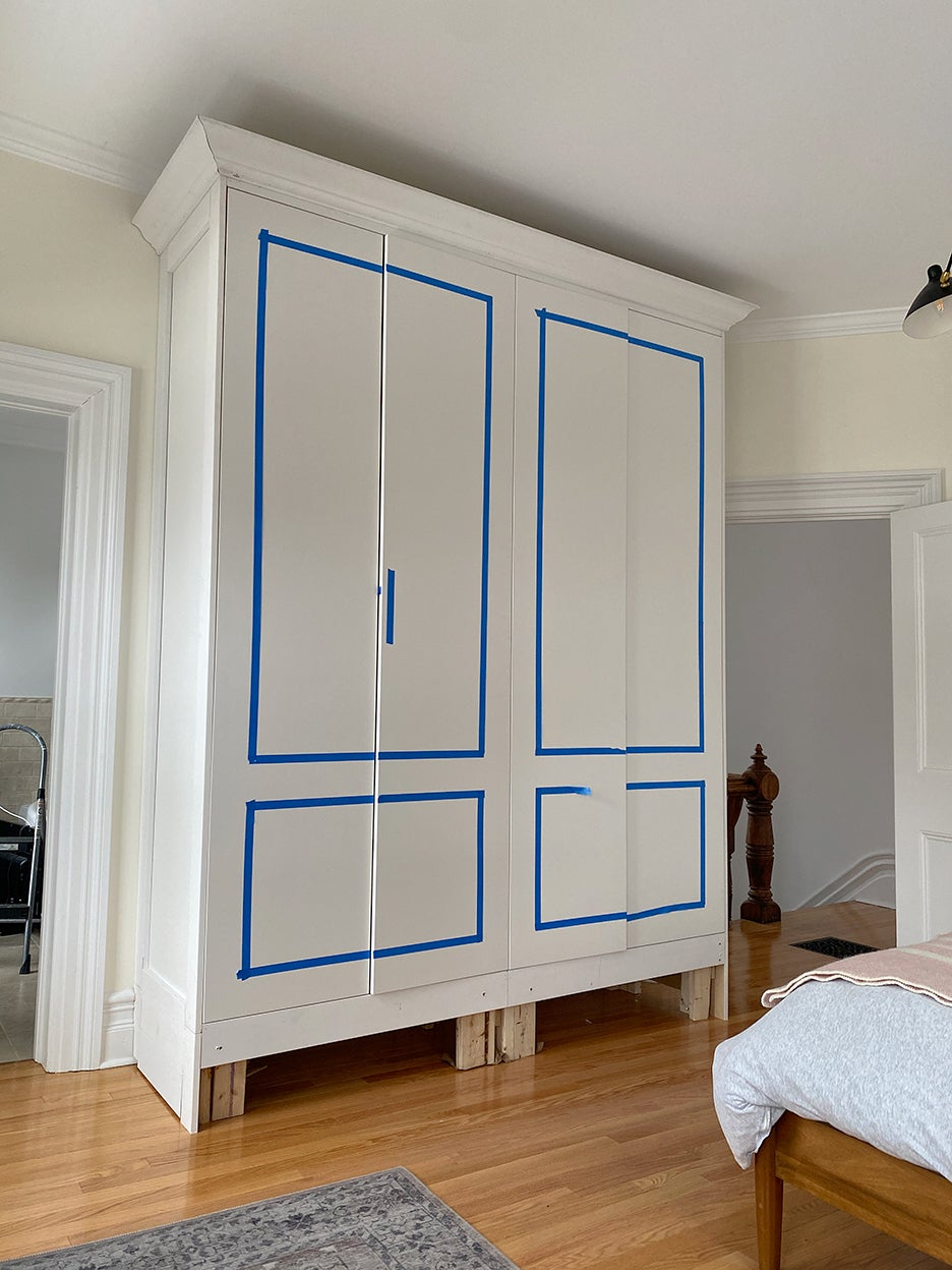 closets with blue tape on the panels