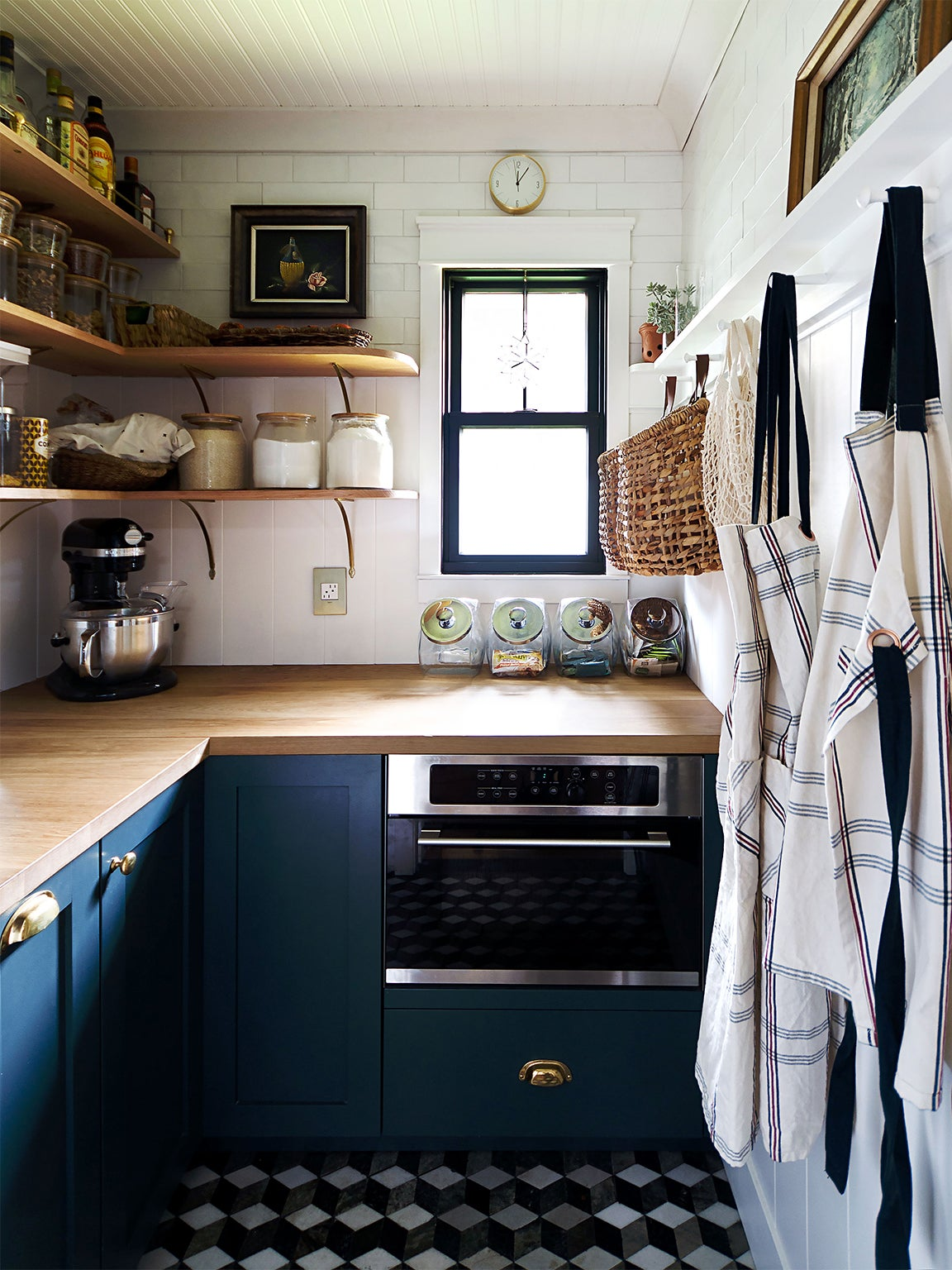 IKEA kitchen cabinets - small kitchen with window and blue cabinets