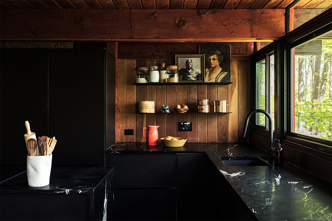 IKEA kitchen cabinets - black and wood kitchen with floating shelves