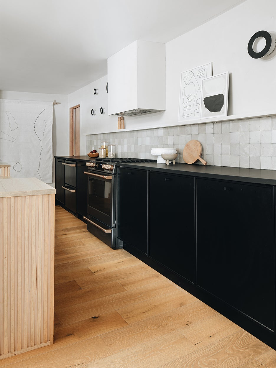 IKEA kitchen cabinets - black cabinets and wood floors