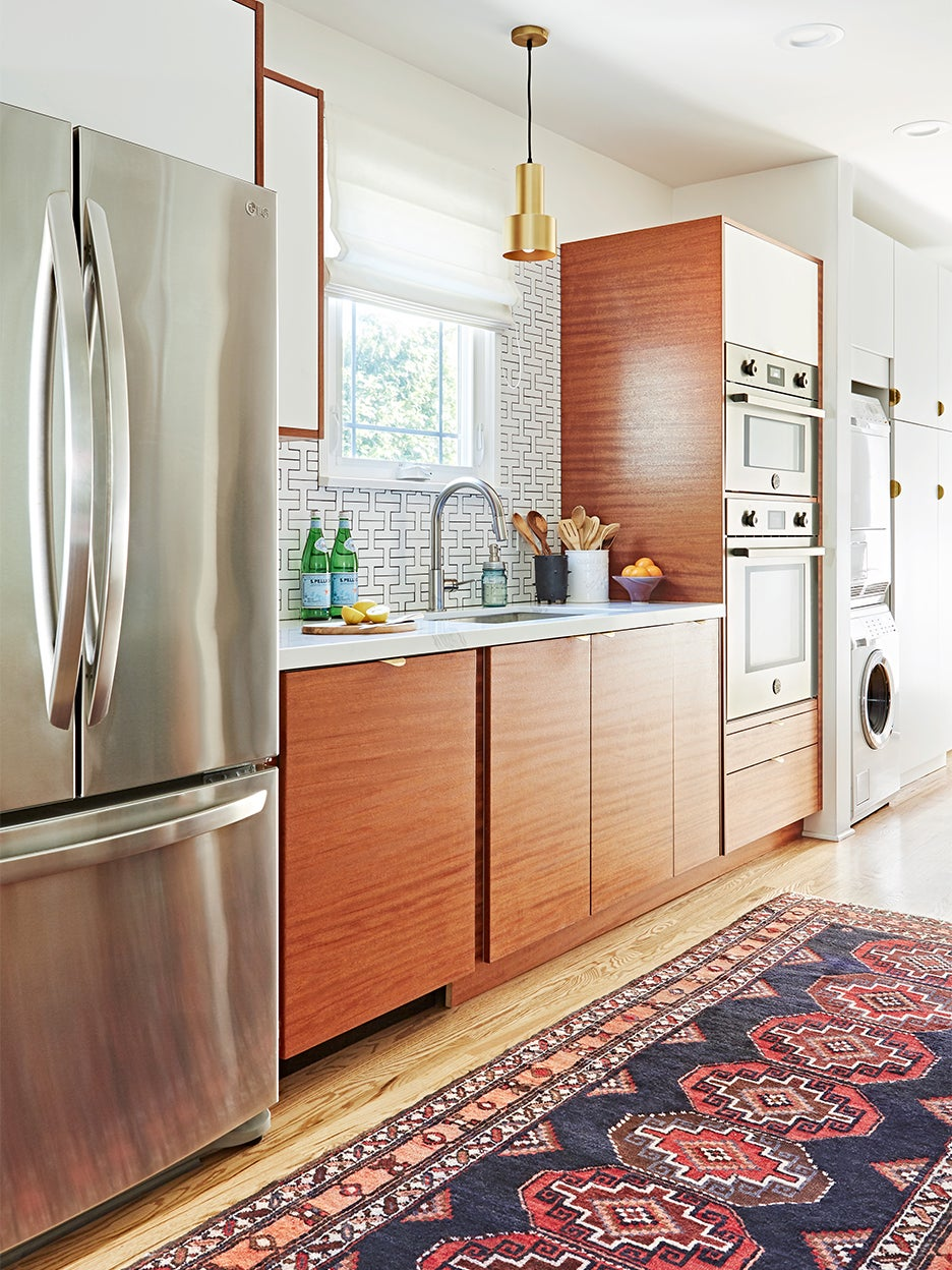 IKEA kitchen cabinets - fridge and wood cabinetry