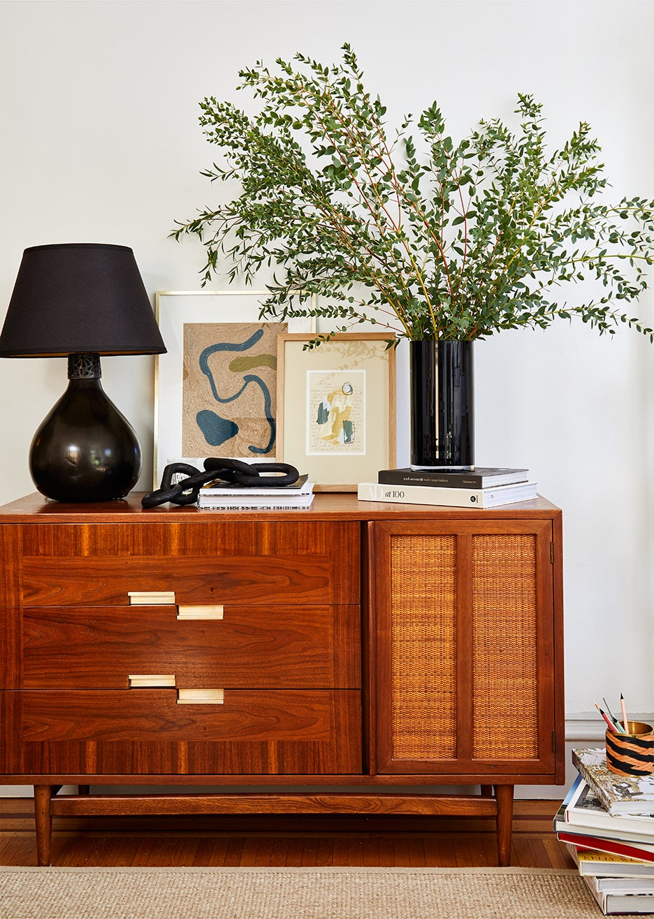 mid century credenza topped with vase and flowers