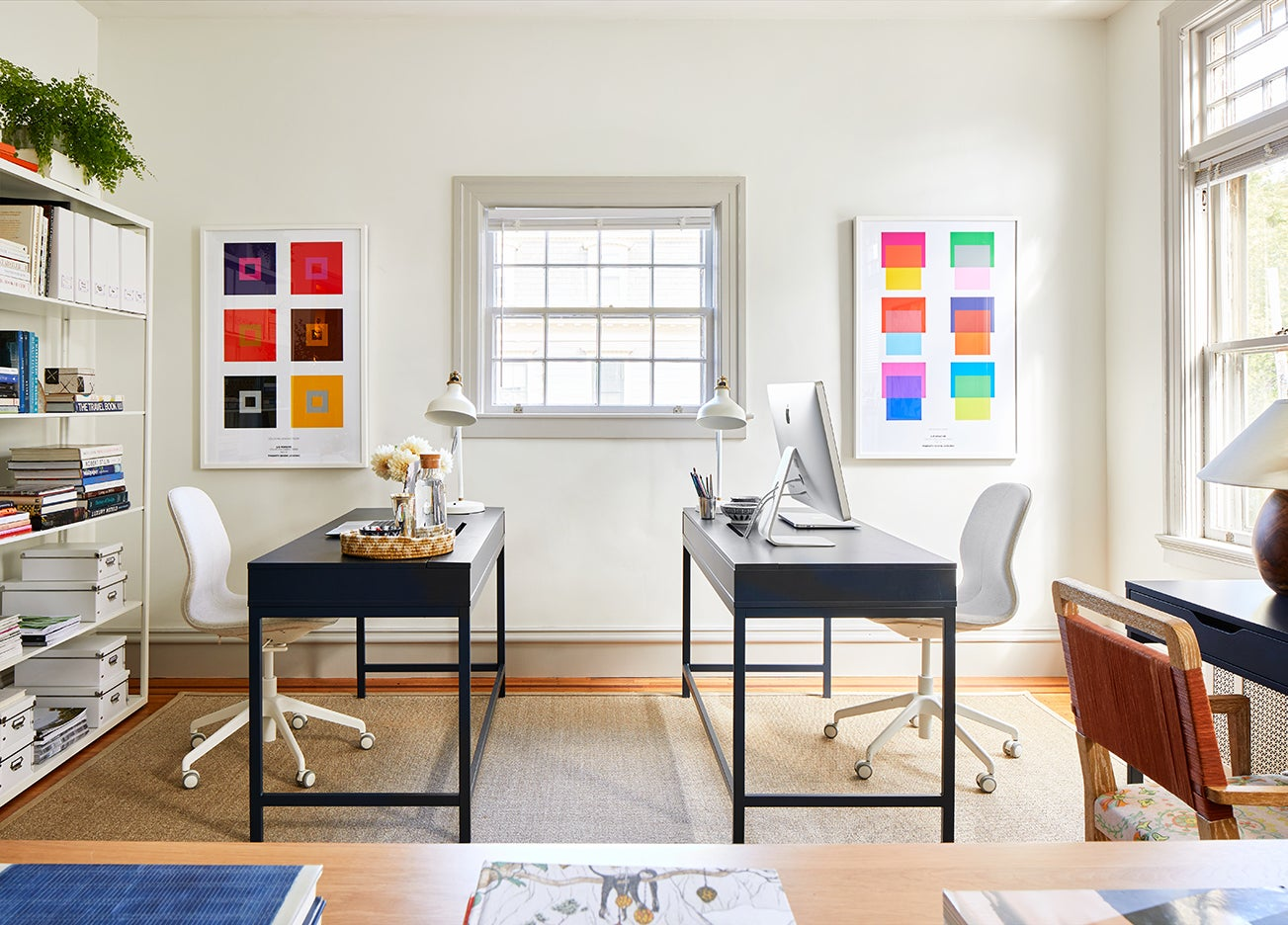 sunny office space with two navy desks