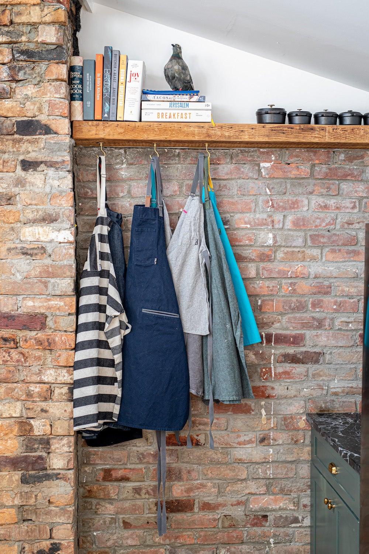 aprons on a rack