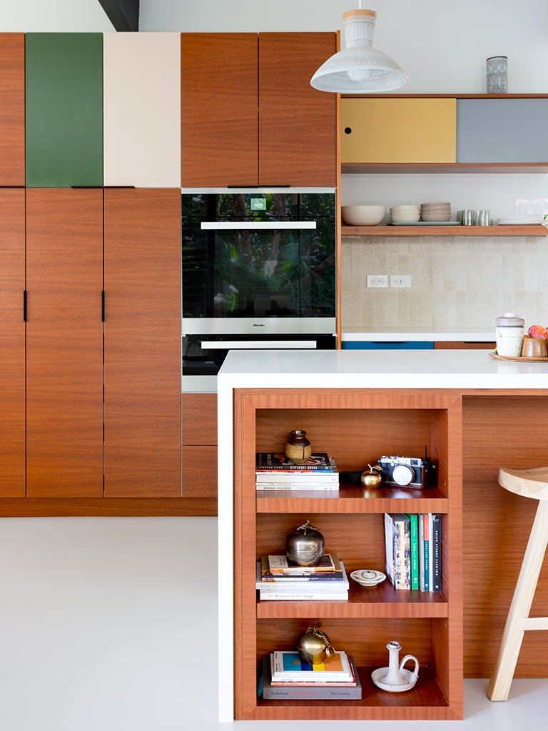 wood cabinets with green and yellow mixed in
