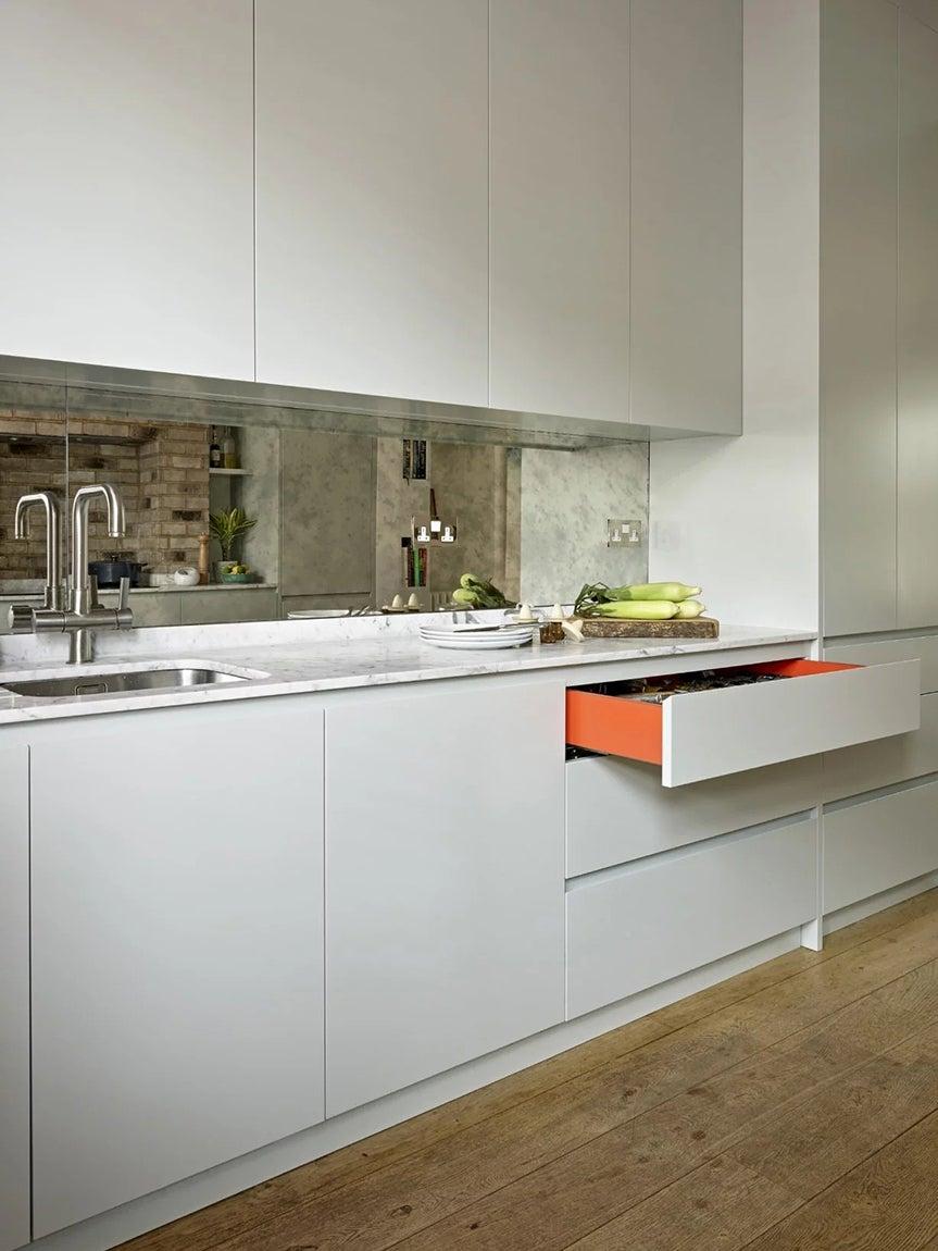orange drawer in white kitchen