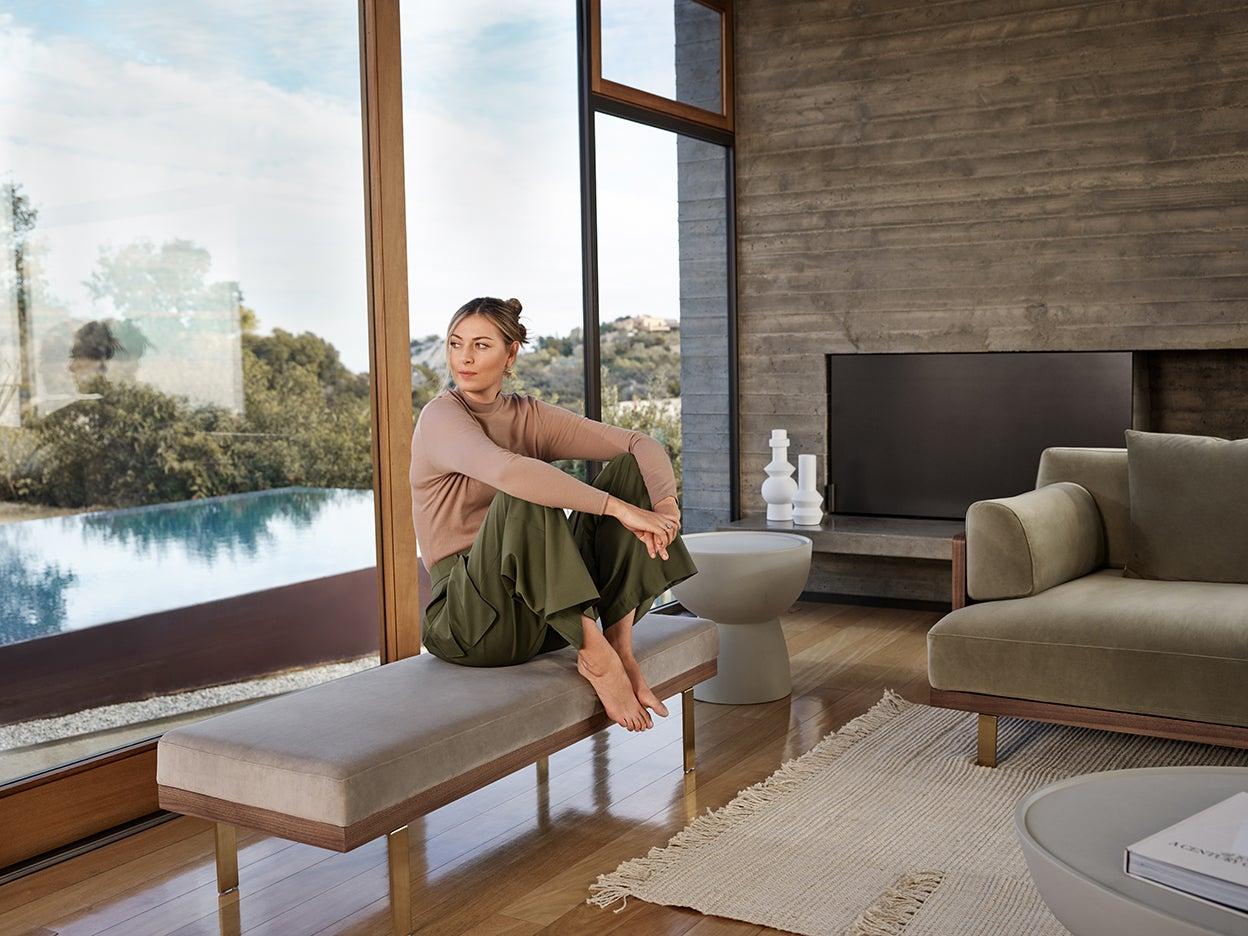 Maria Sharapova sitting on a bench she designed