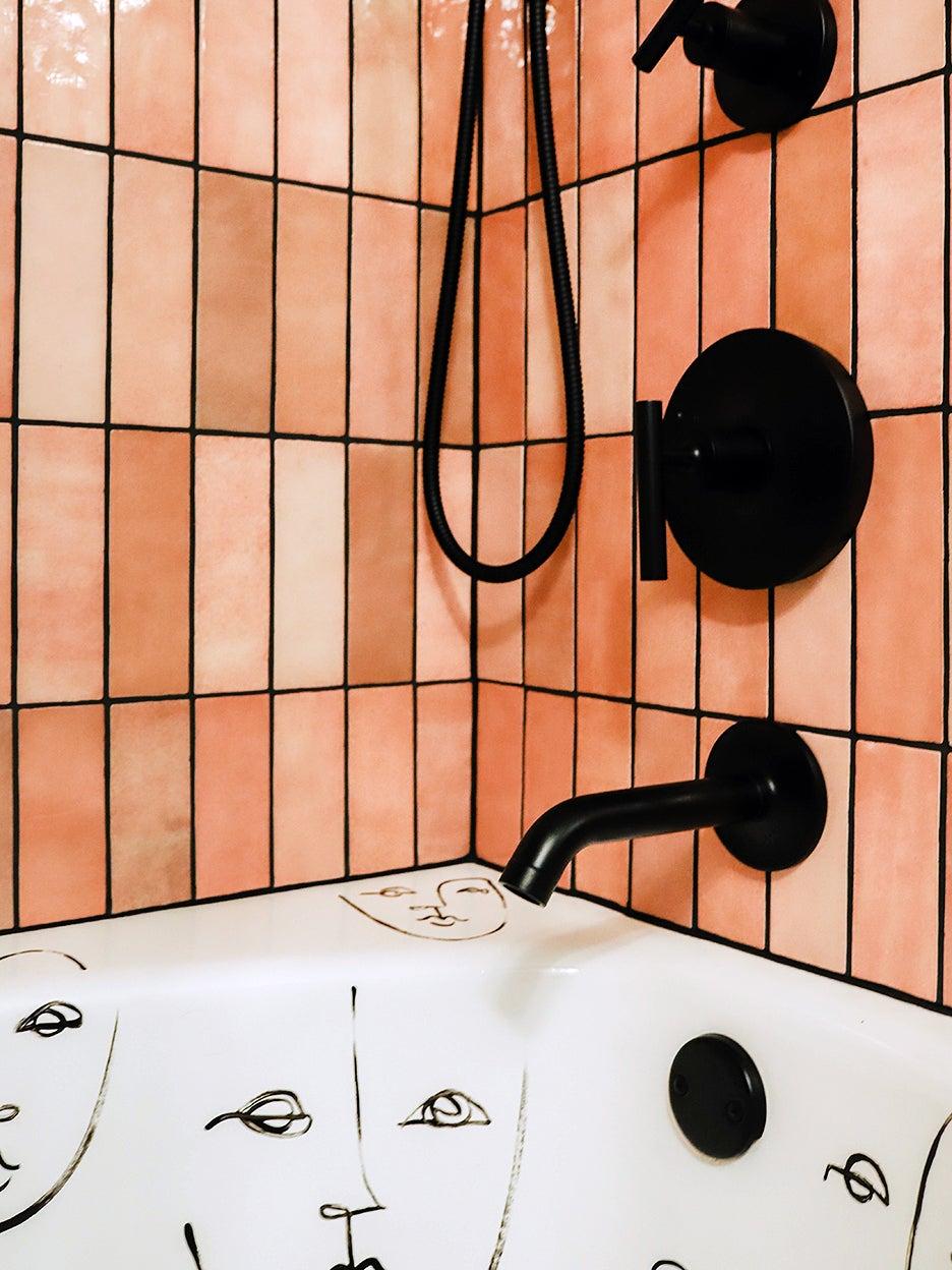 corner of pink tiled shower-tub
