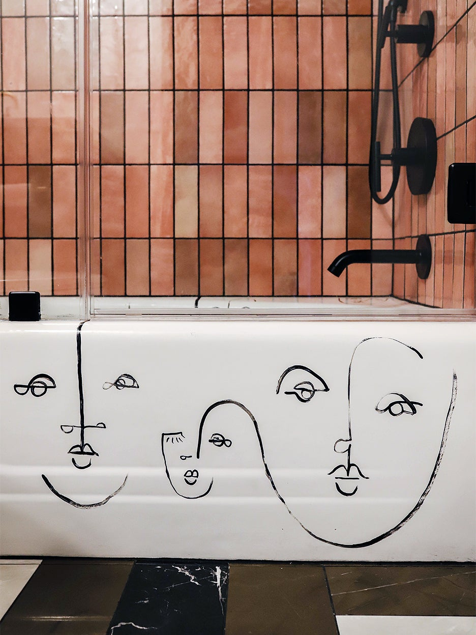 abstract faces on side of white tub