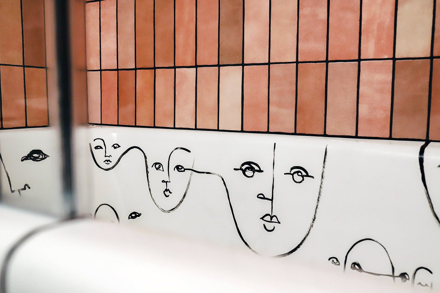 abstract faces drawn inside tub