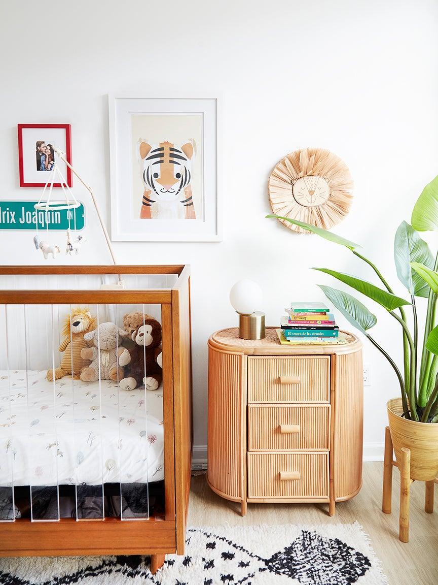teak crib next to rattan dresser