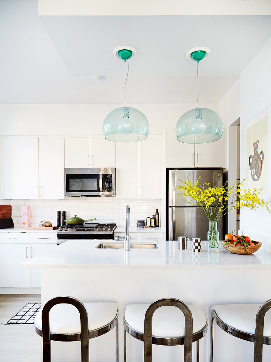 white kitchen with metal bar stools